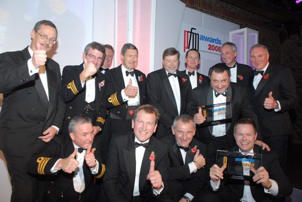 The winning Interserve and MoD team with  (far left standing) sponsor, Steve Francis of sponsors of Barclays